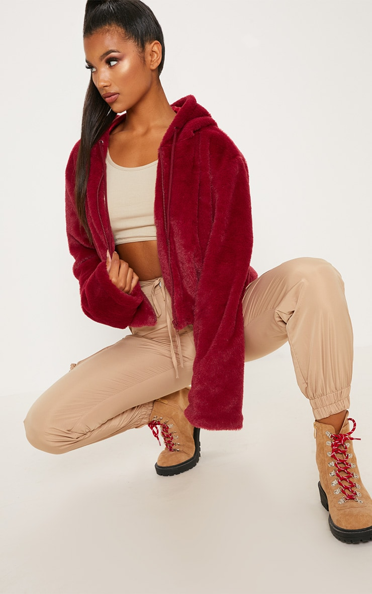 Burgundy Cropped Faux Fur Zip Through Hoodie  by Prettylittlething