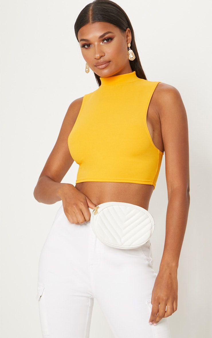 95ff1671f3e Mustard High Neck Sleeveless Crop Top | PrettyLittleThing