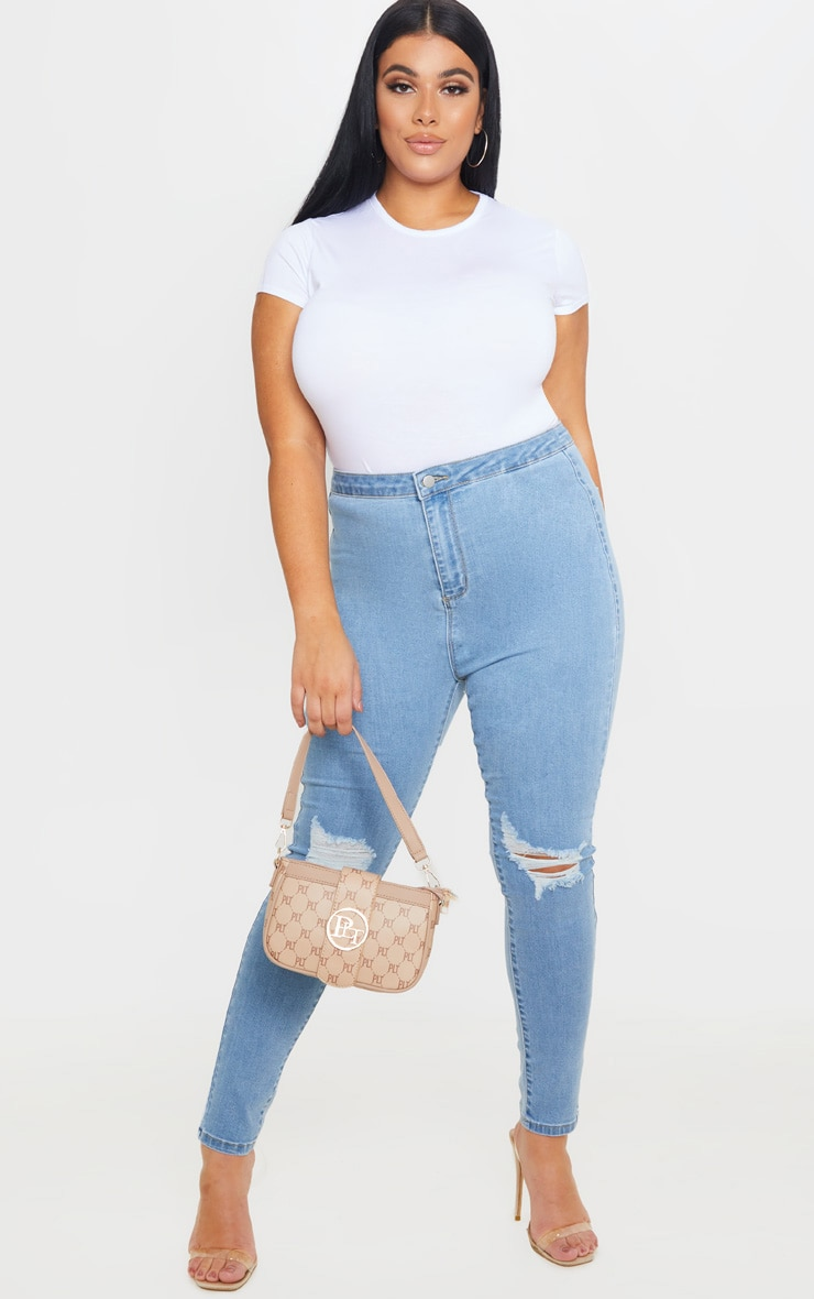 PRETTYLITTLETHING Plus Light Wash Knee Rip Disco Skinny Jean 1