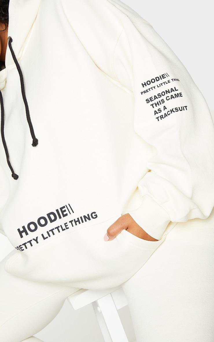 PRETTYLITTLETHING Plus Cream Oversized Slogan Print Pocket Front Hoodie 4