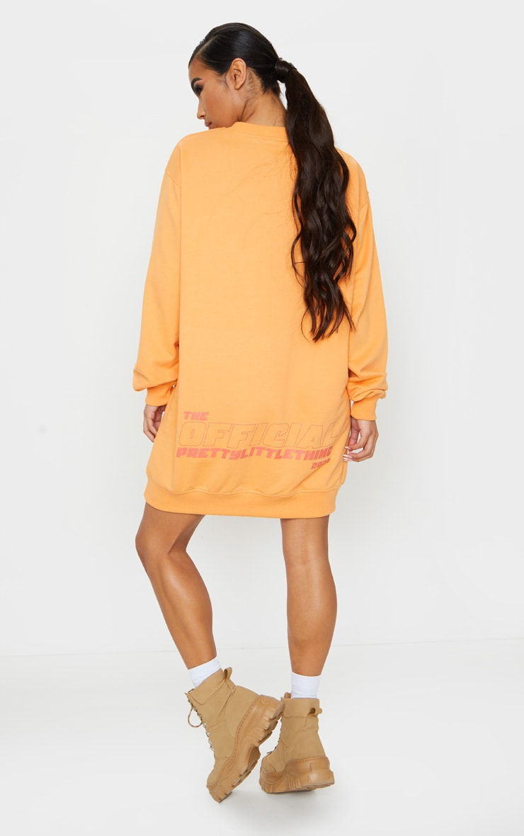 PRETTYLITTLETHING Orange Official Slogan Back Print Long Sleeve Jumper Dress 1