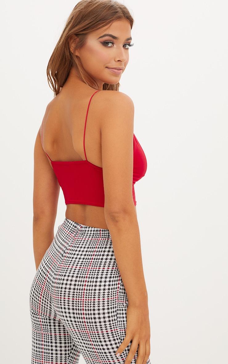 بلوزة قصيرة بحمالات رفيعة لون أحمر 2