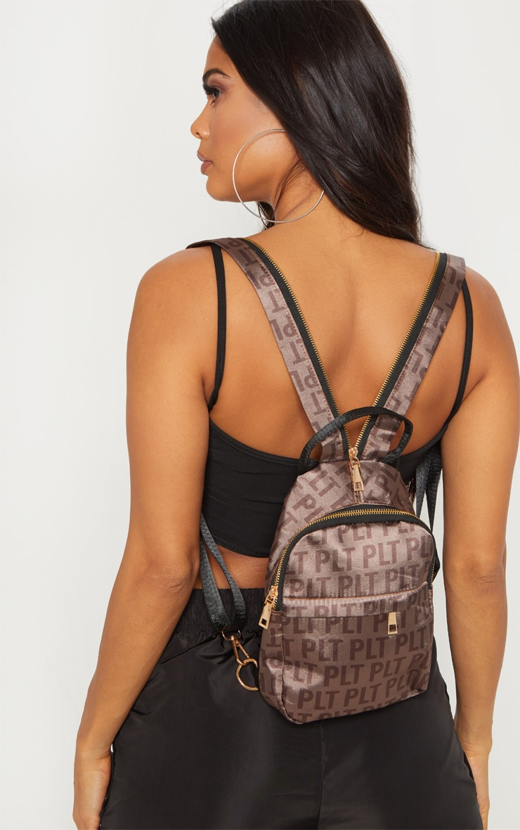 PRETTYLITTLETHING Brown Logo Satin Backpack 1
