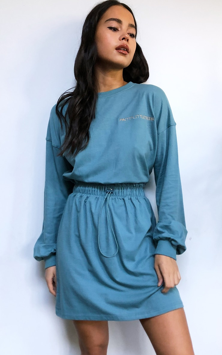 PRETTYLITTLETHING Slogan Washed Teal Toggle Waist T-Shirt Dress 1