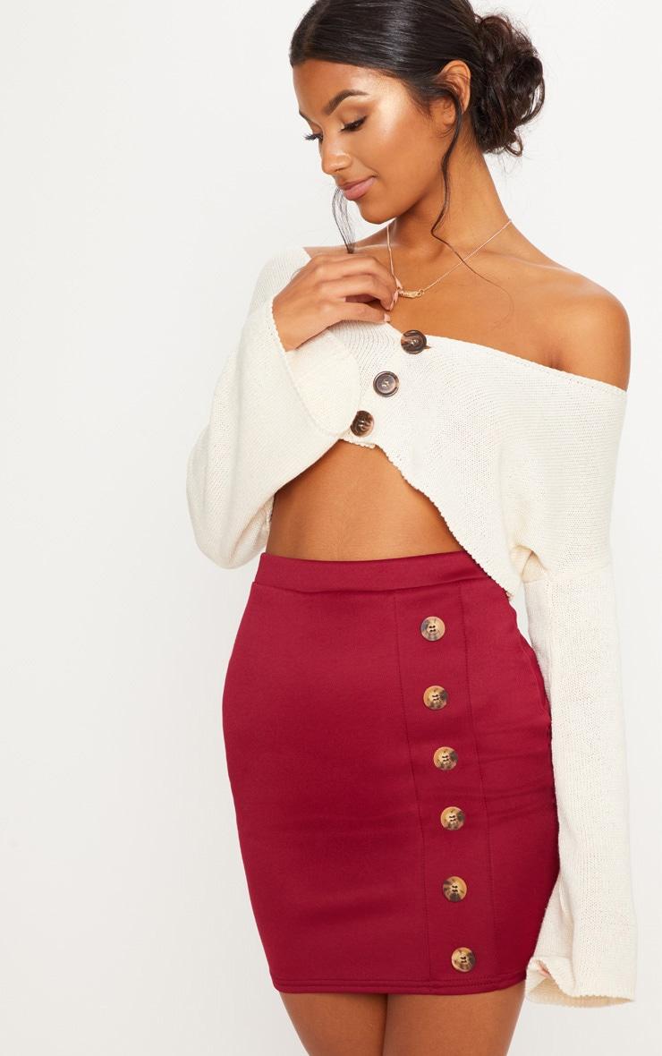Mini-jupe pourpre à boutons