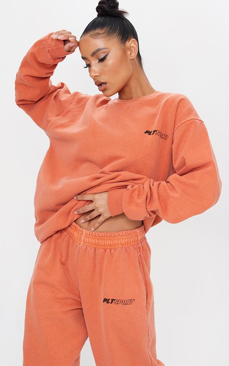 PRETTYLITTLETHING Rust Oversized Sport Sweater 1