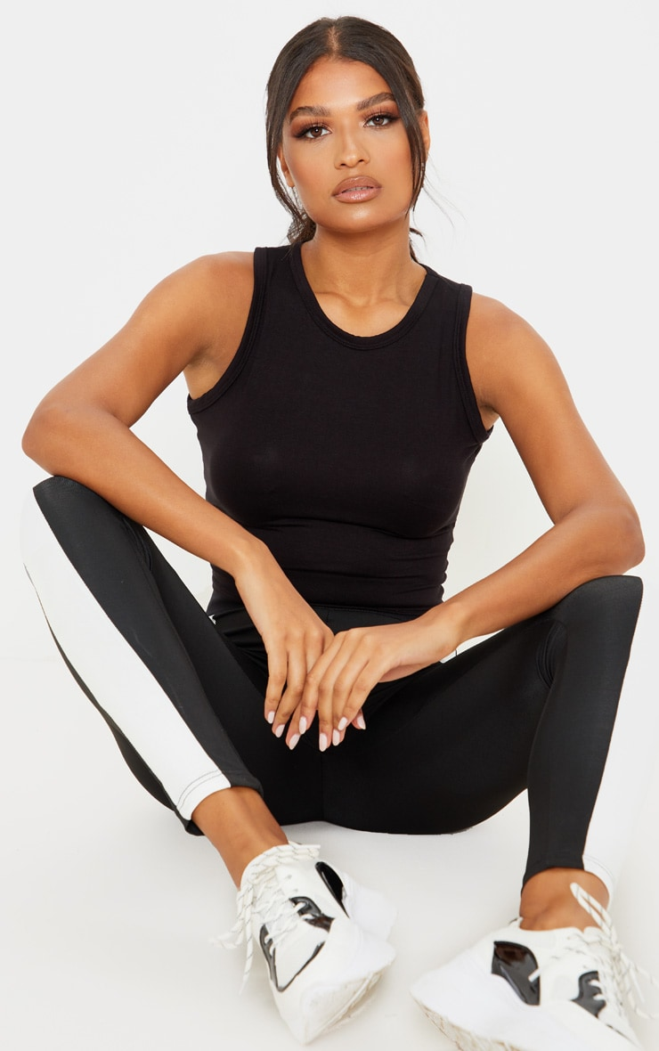 PRETTYLITTLETHING Black Knot Back Cropped Gym Top 4