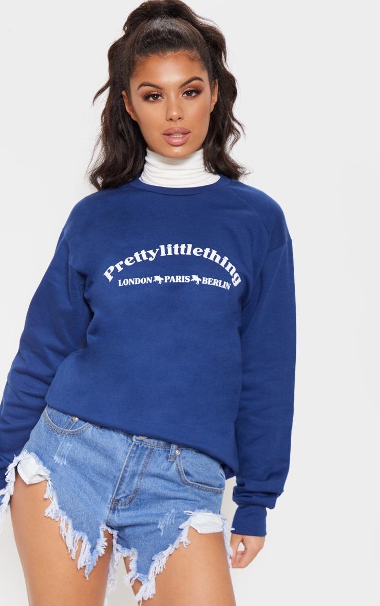Sweat oversize bleu marine à slogan écriture PrettyLittleThing Europe 1