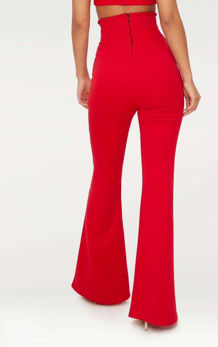 Pantalon flare rouge à taille élastifiée incurvée  4