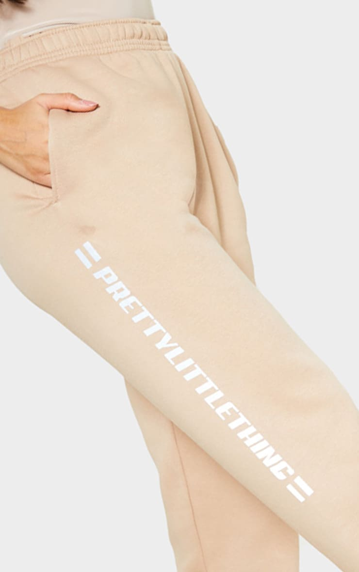 PRETTYLITTLETHING Taupe Reflective Print Track Pants 5