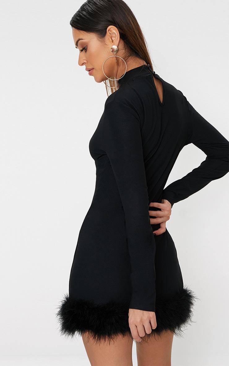 Robe moulante manches longues col haut ourlet à plumes noire 2