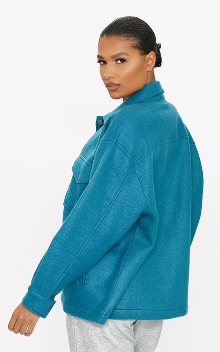 Veste style chemise bleu sarcelle à poches devant 2