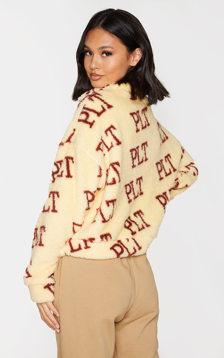 PRETTYLITTLETHING Cream Borg Pocket Half Zip Sweatshirt 2