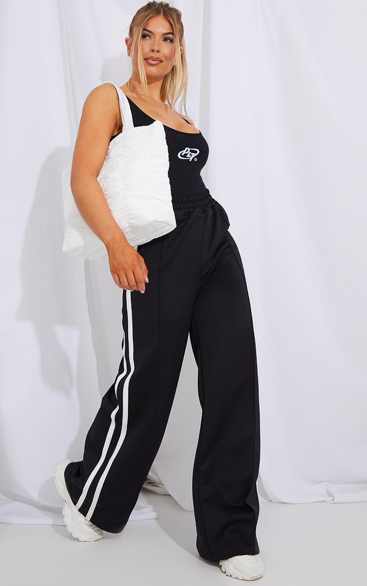 PRETTYLITTLETHING Black Rib Circle Logo Bodysuit 3