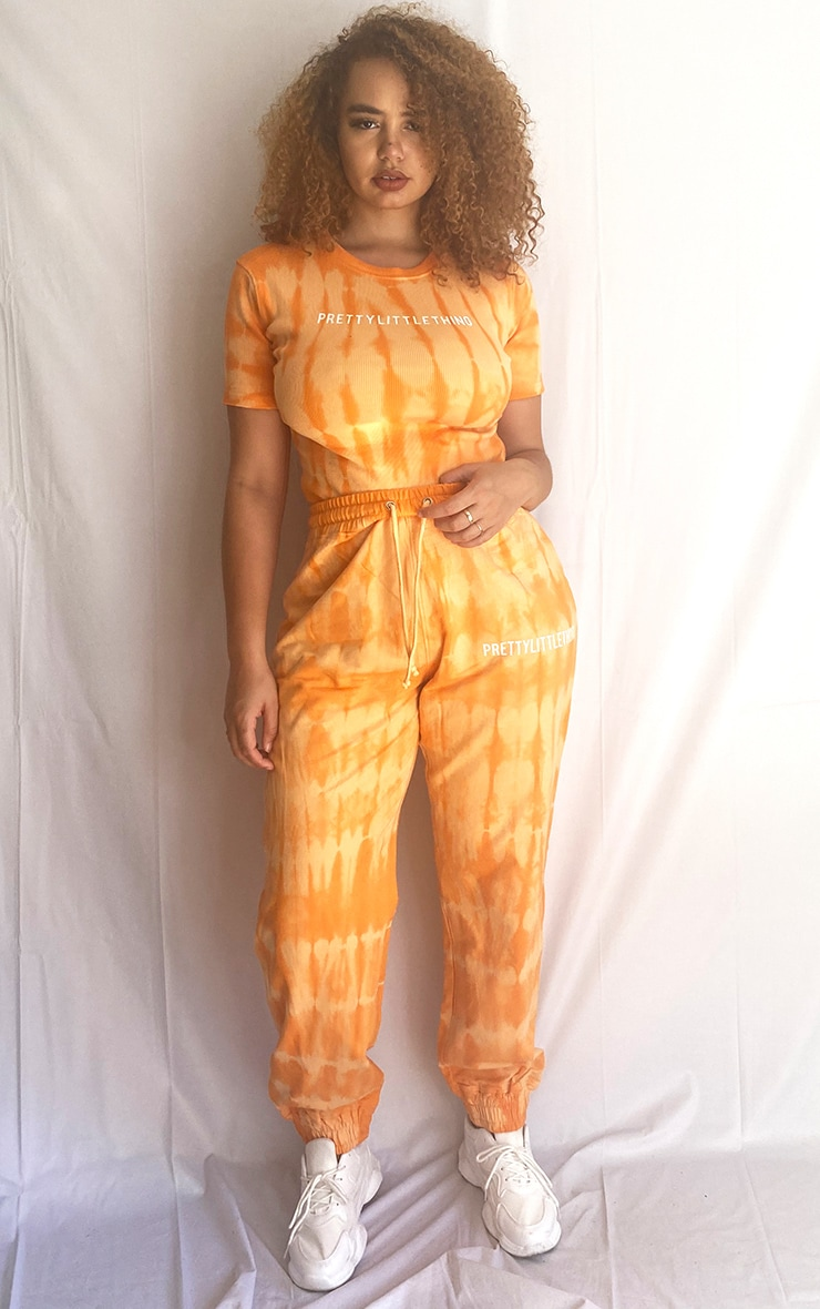 PRETTYLITTLETHING Plus Orange Tie Dye Washed Jogger 1