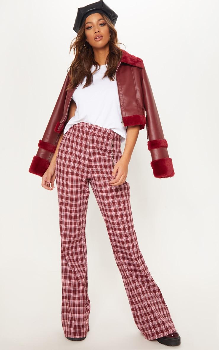 Pantalon à jambes évasées en laine bordeaux à carreaux