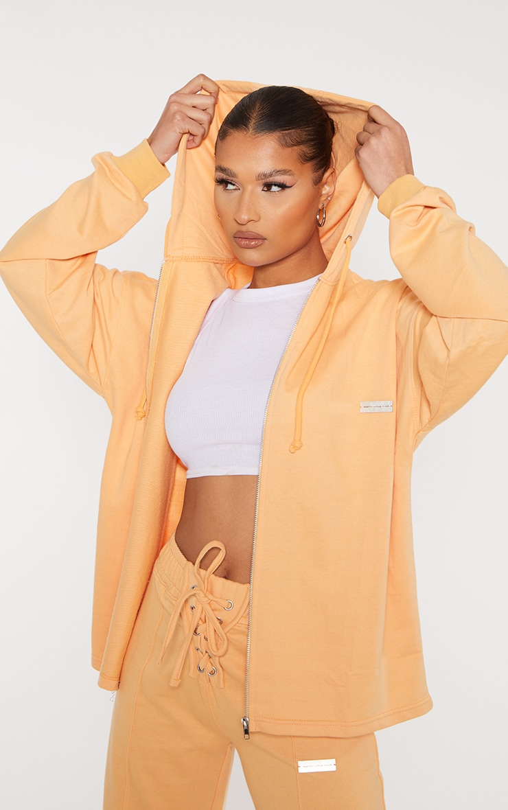 Prettylittlething Peach Oversized Metal Badge Zip Through Hooded Jacket