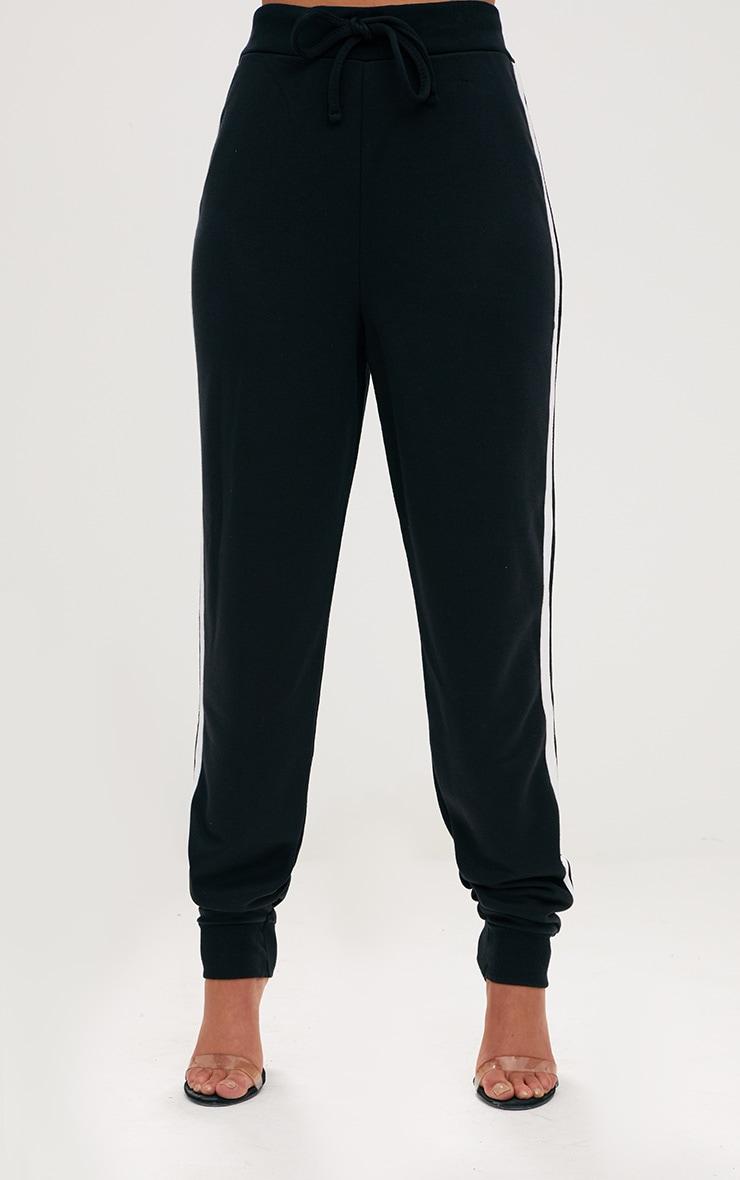 Jogging noir à rayures contrastantes  2
