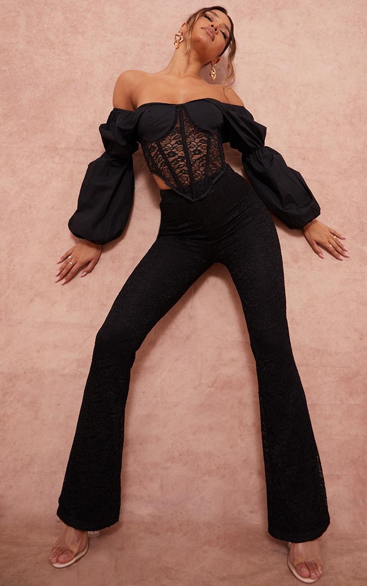Pantalon flare noir en maille et dentelle à taille haute 1