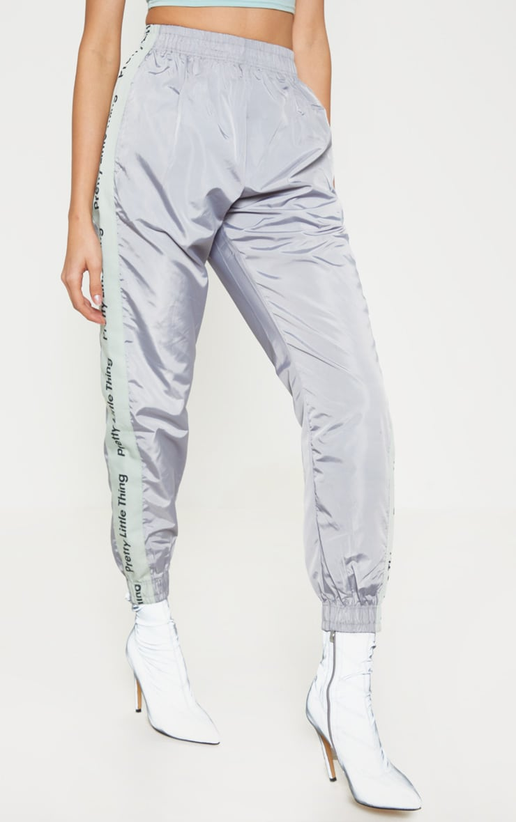 PRETTYLITTLETHING Silver Side Tape Shell Jogger 2
