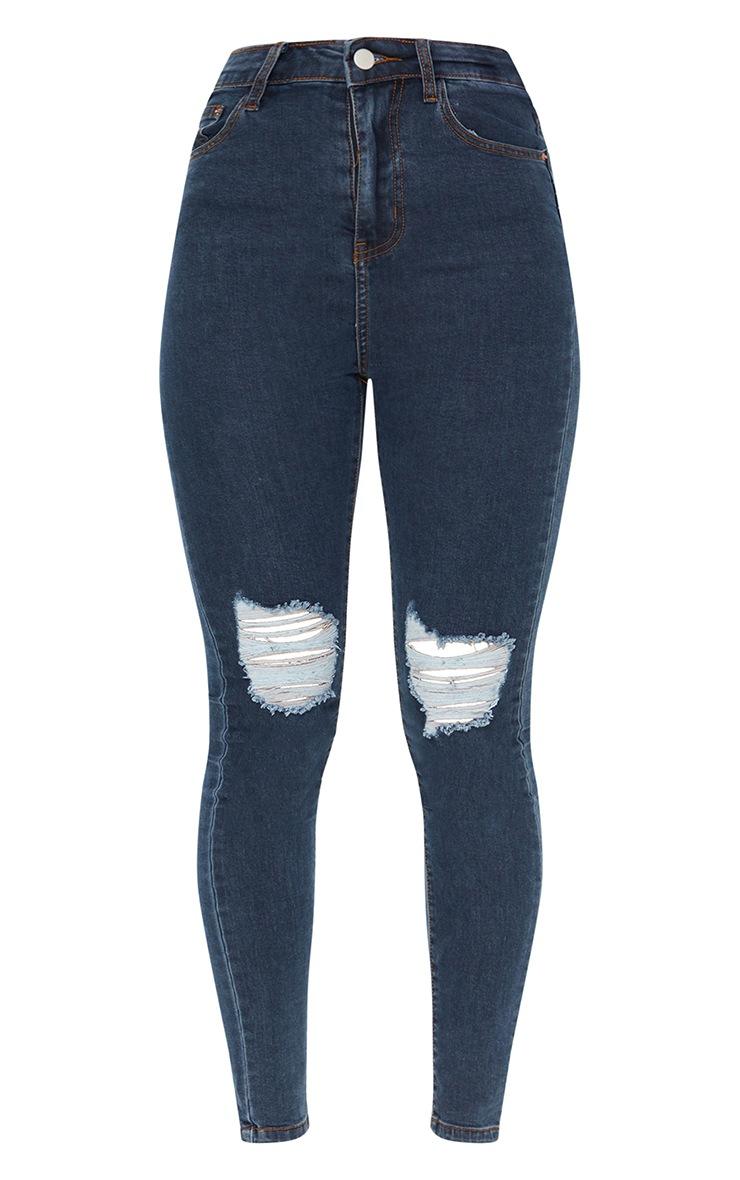 سراويل الجينز الضيق  مزود بخمسة جيوب بتصميم كلاسيكي، لون أزرق داكن، ممزق عند الركبة من بريتي ليتل ثينج 5