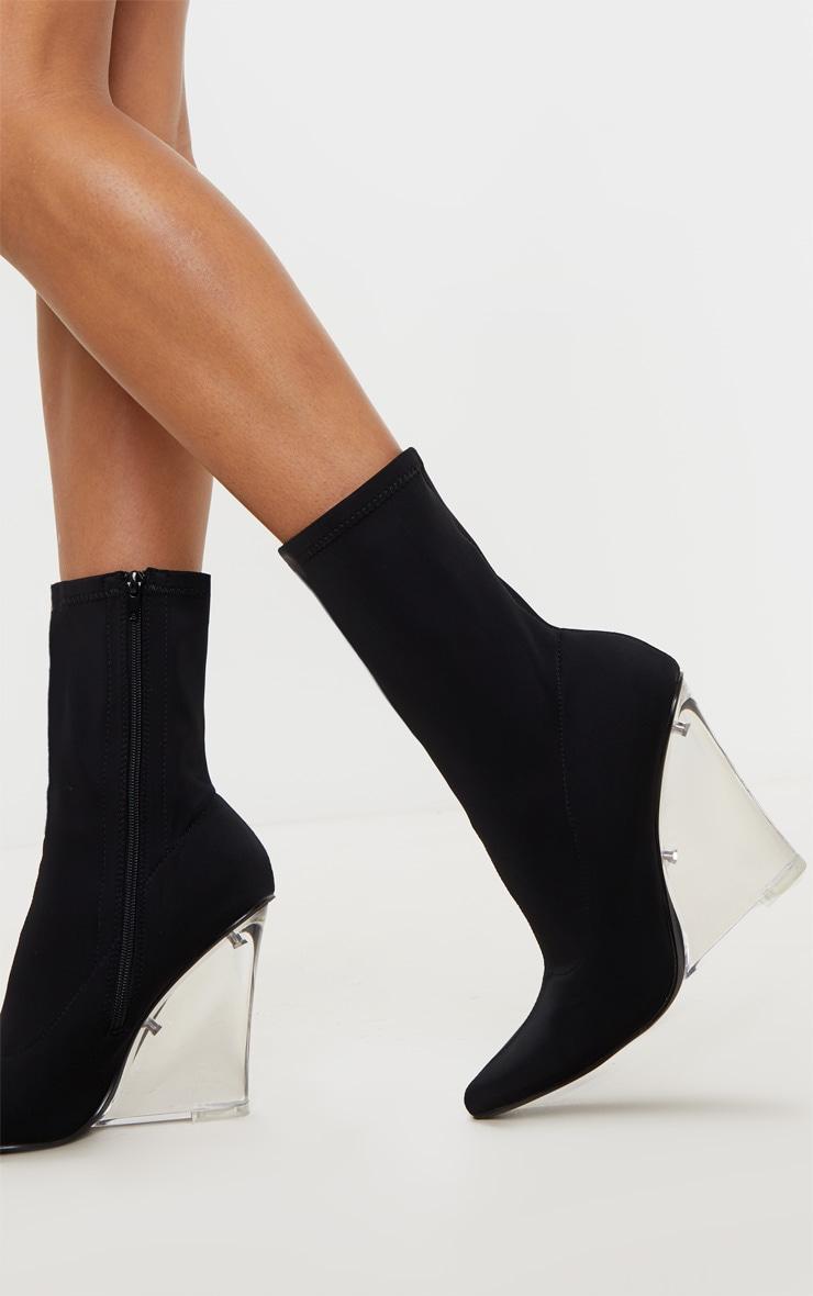Bottines chaussettes pointues noires à talon compensé transparent 1