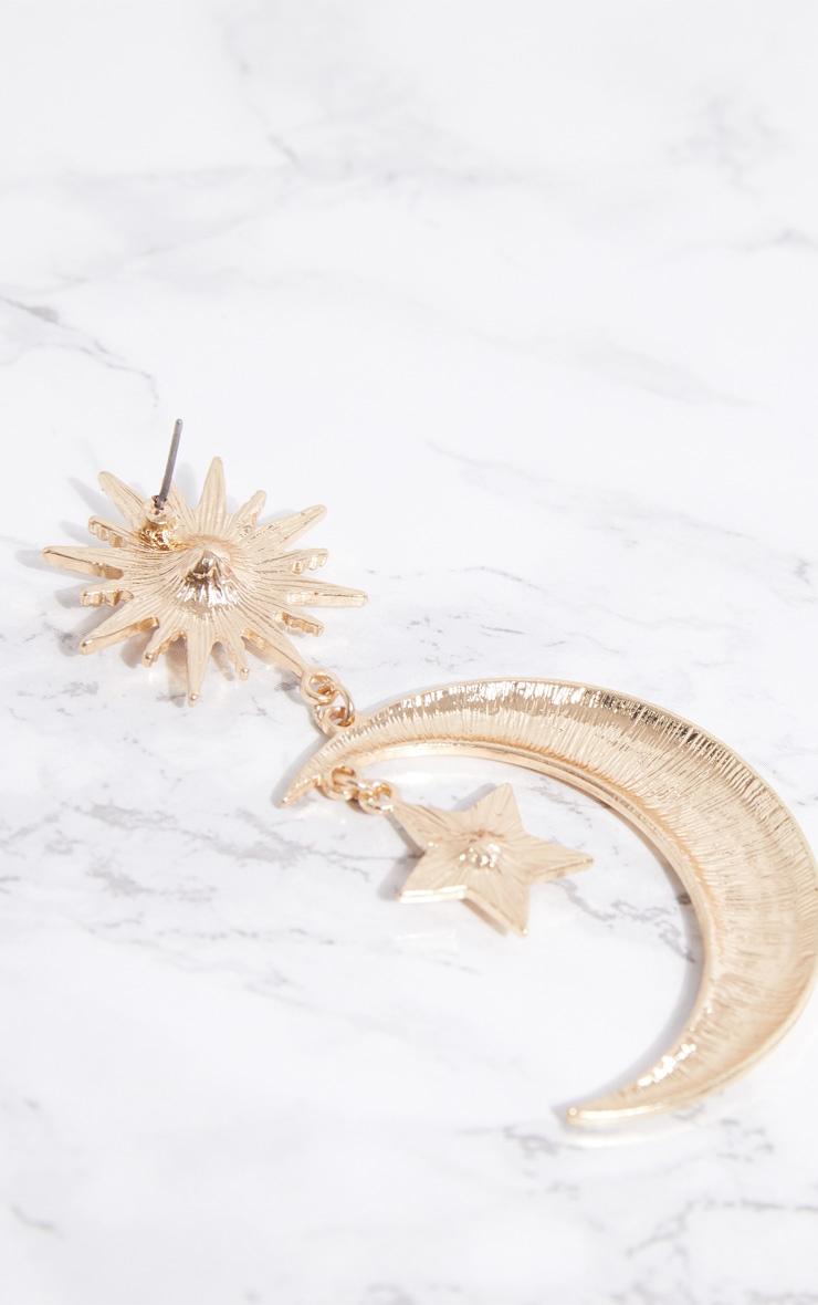 Boucles d oreilles dorées à soleil, étoile et pierres fantaisie bleues 4