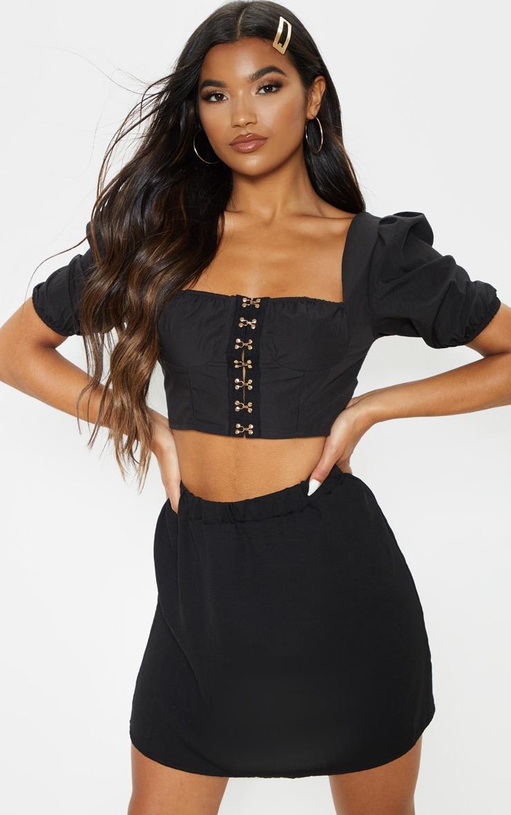 Mini-jupe en maille légère tissée noire 1