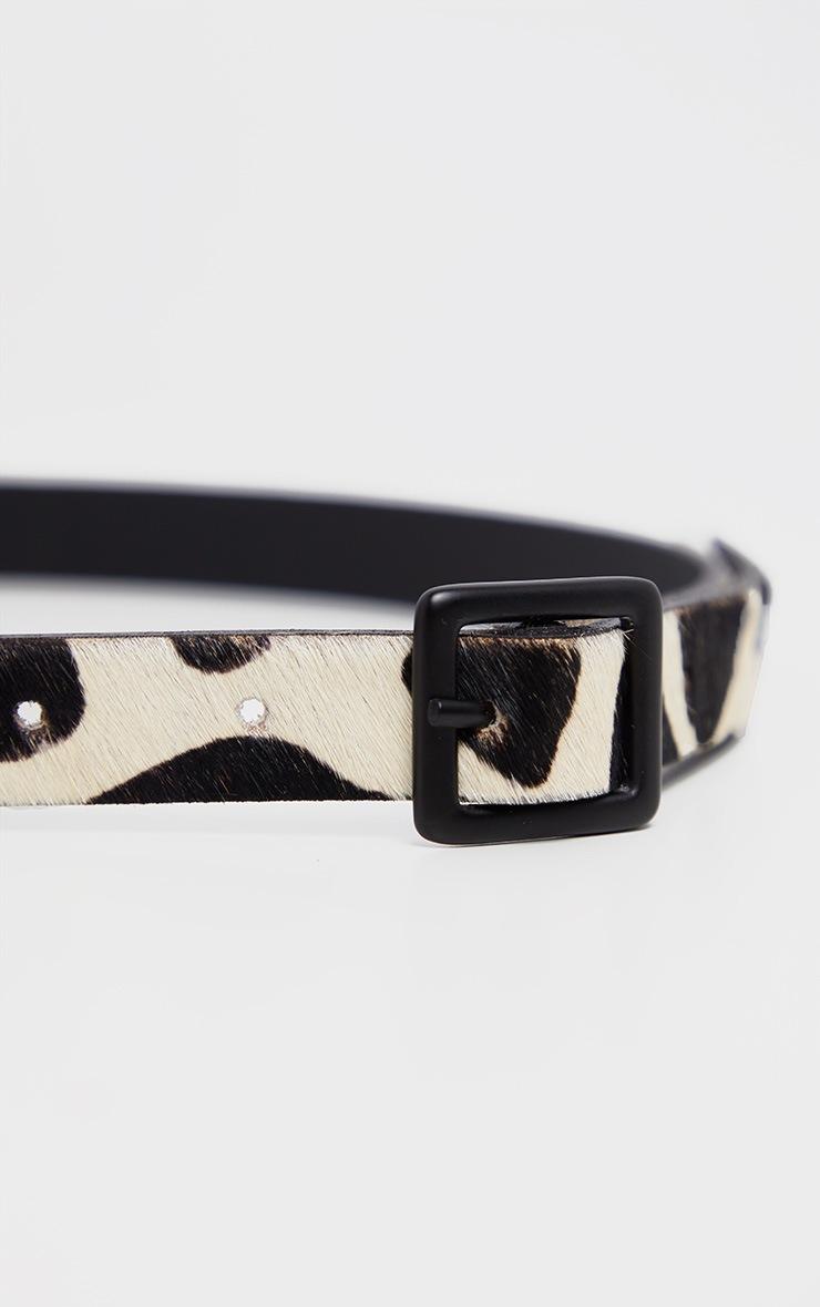 Ceinture fine noire & blanche imprimé vache en faux poils de poney 3