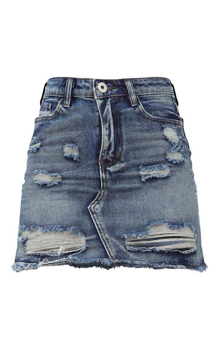 Minijupe en jean déchiré et vieilli à délavage vintage 3