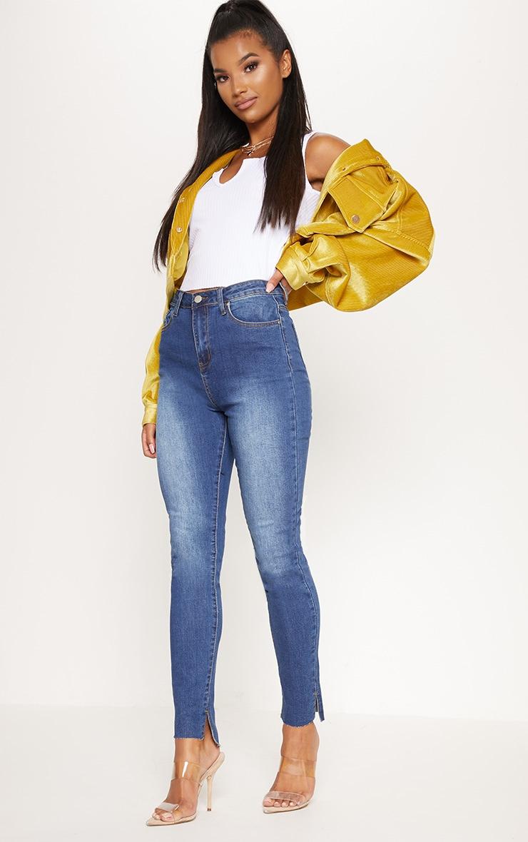 Mid Wash Split Hem High Waisted Skinny Jean by Prettylittlething