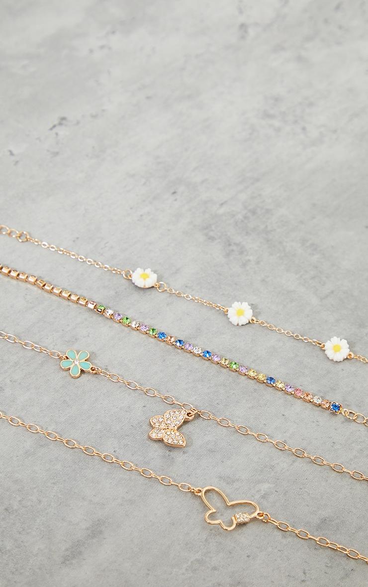 Assortiment de bracelets dorés à strass pastel et papillons 2