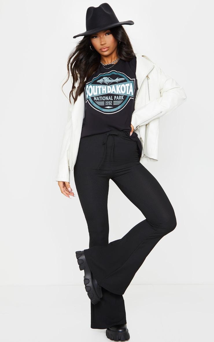 Pantalon flare côtelé noir à détail noué 1