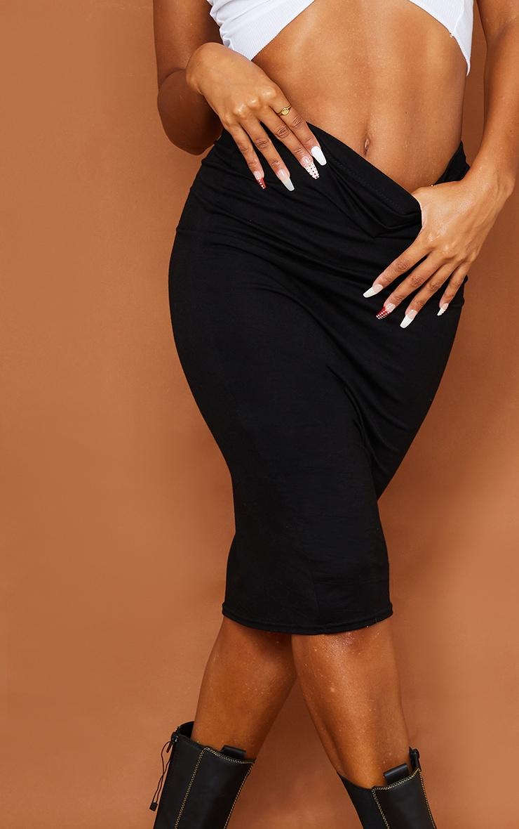 تنورة متوسطة الطول من قماش الجيرسي باللون الكاكي والأسود السادة - قطعتين 4