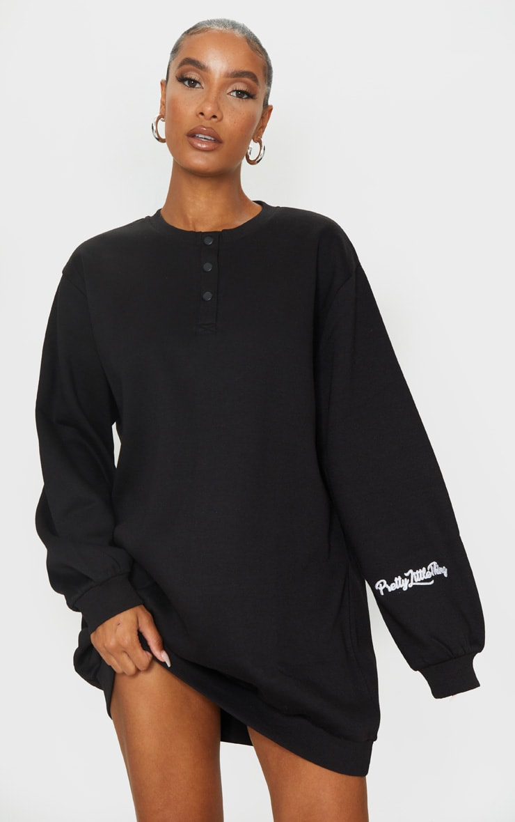 PRETTYLITTLETHING Black Embroidered Popper Sweater Dress 1
