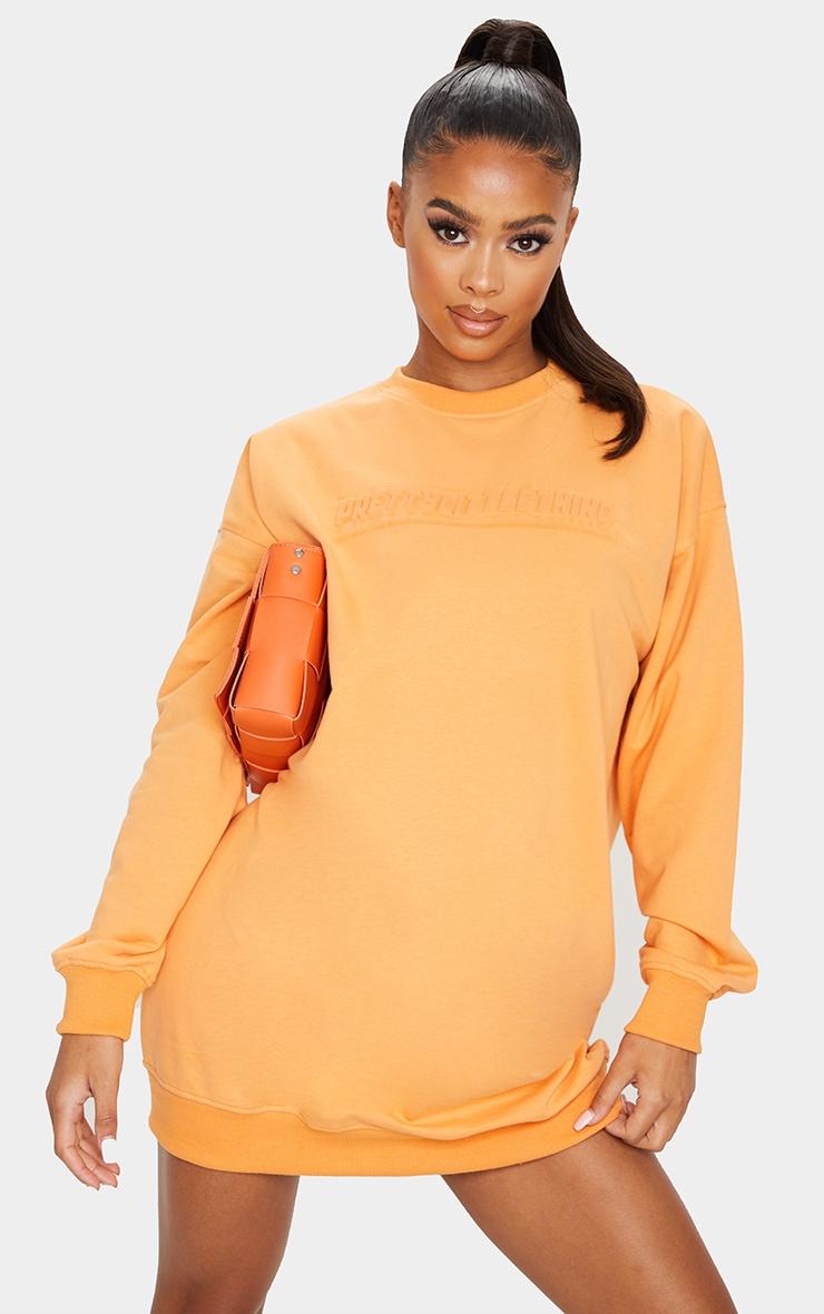 PRETTYLITTLETHING Orange Embossed Slogan Sweat Jumper Dress 1