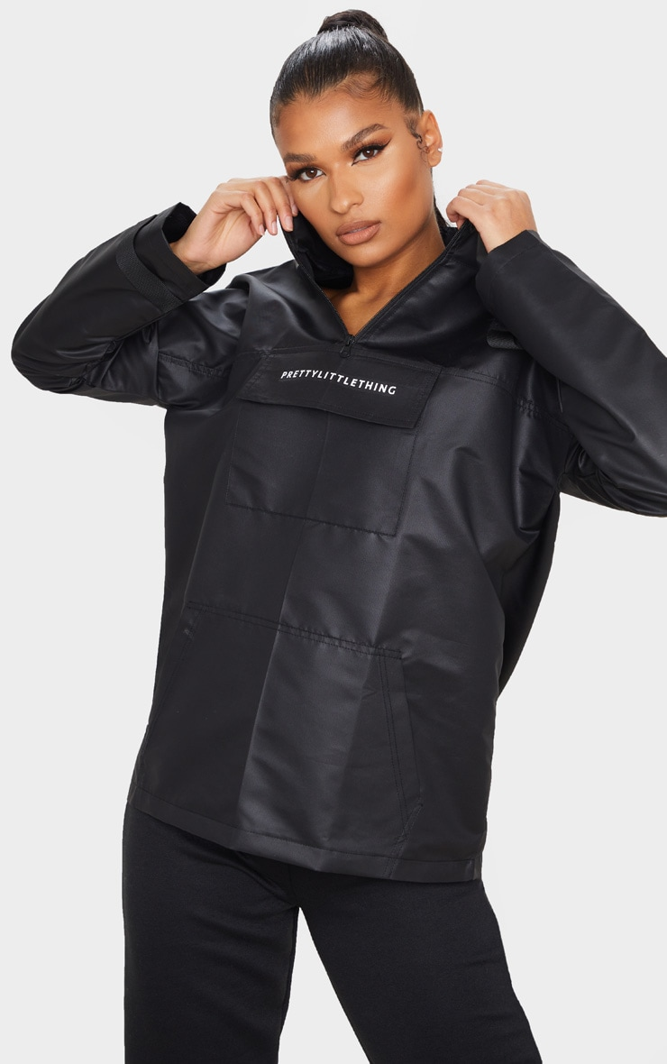 PRETTYLITTLETHING Black Pocket Front Hooded Pull Over Mac 1