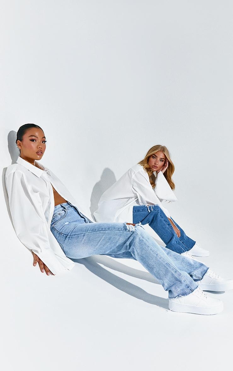PRETTYLITTLETHING Petite Light Blue Wash Distressed Long Leg Straight Jean 5