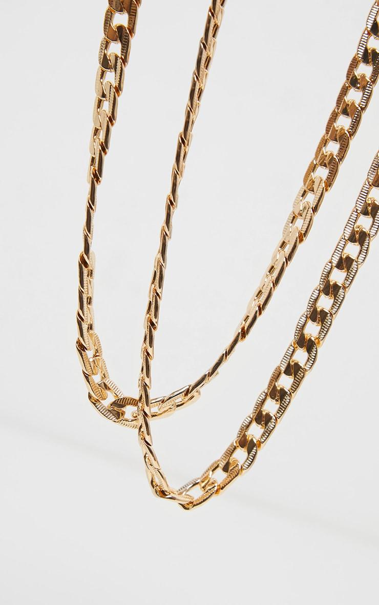 Ras-de-cou à double chaîne dorée 3