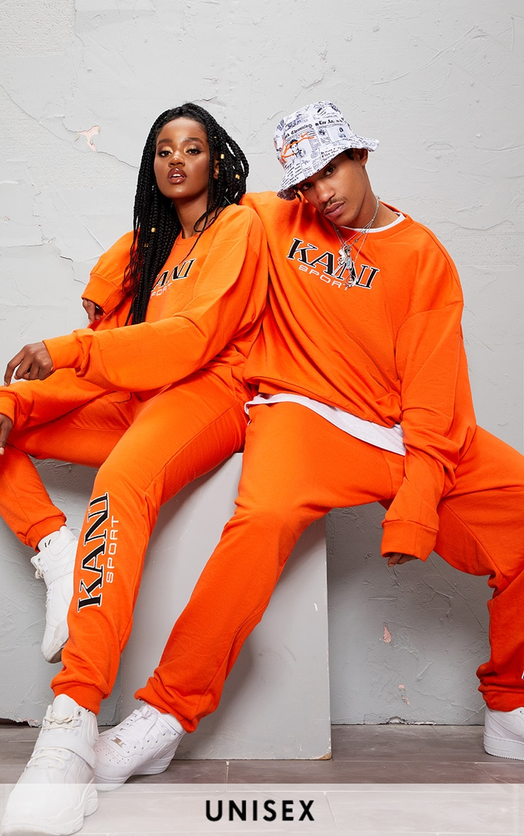 KARL KANI ORANGE EMBROIDERED JOGGERS