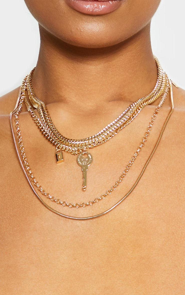 Collier doré à chaînes multiple cadenas et clé 1