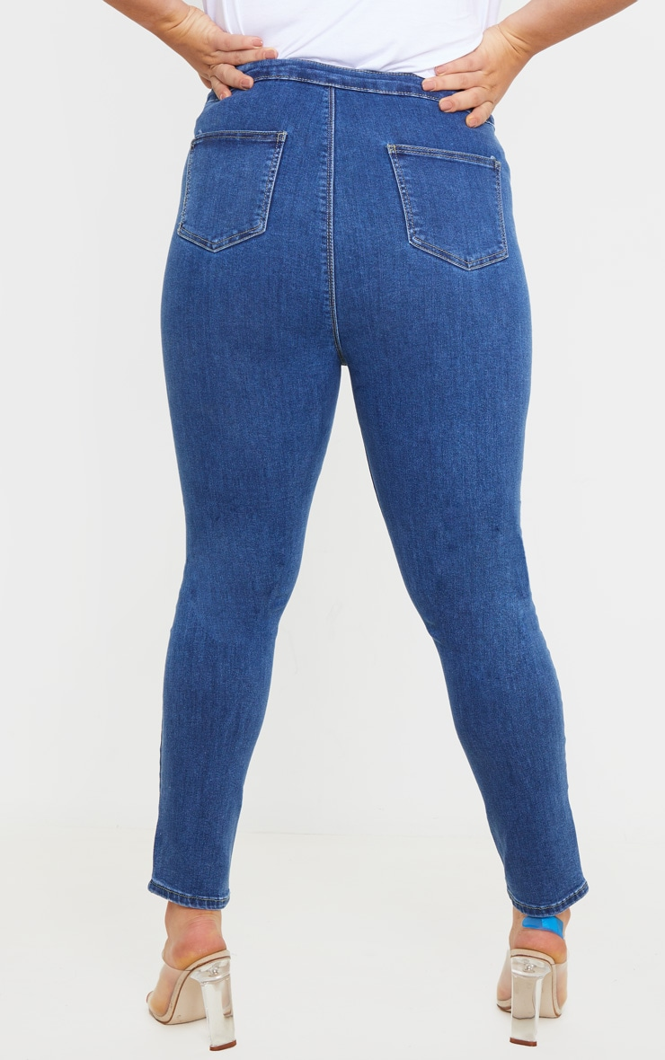 PRETTYLITTLETHING Plus Mid Blue Distressed Disco Jean 4
