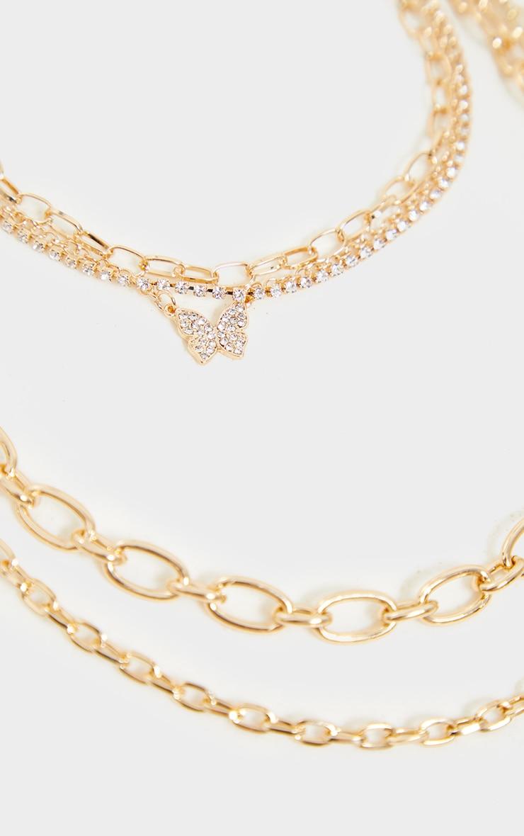 Collier fin à 5 chaînes superposées dorées à papillons 4