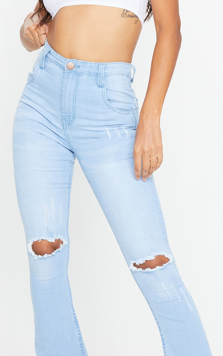 Mid Blue Distressed Knee Flare Jean 4