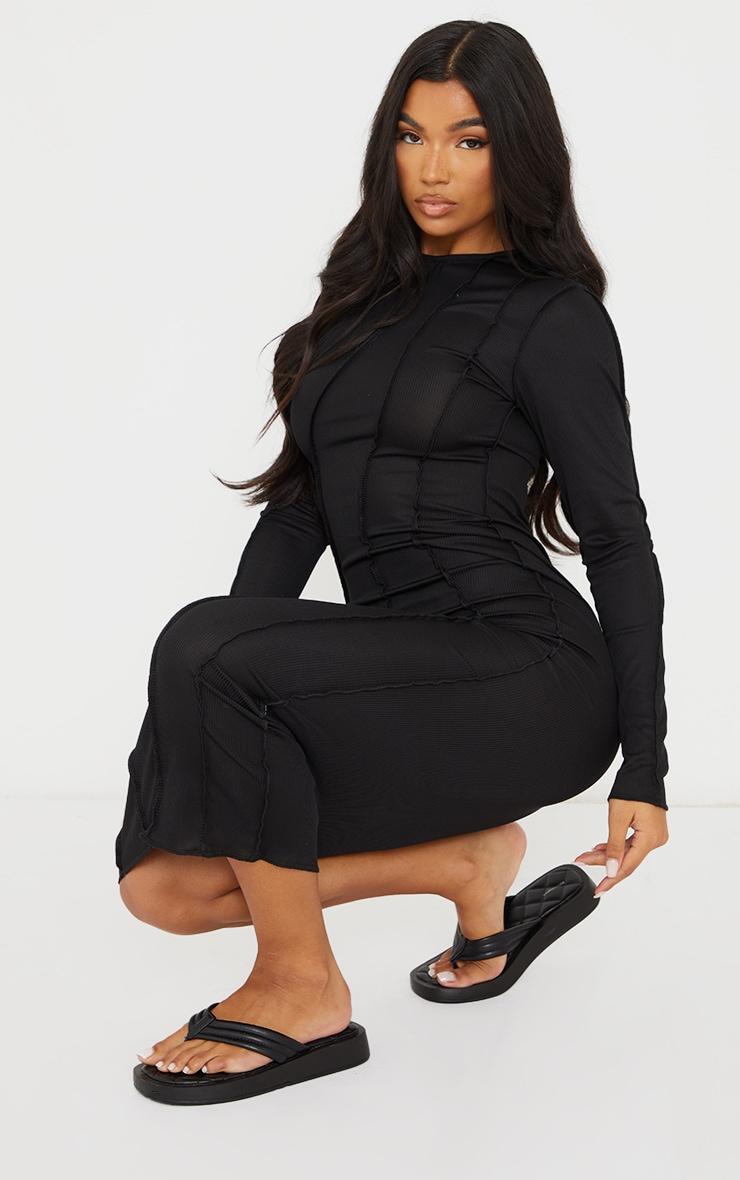 Robe longue noire manches longues côtelée à coutures asymétriques 3