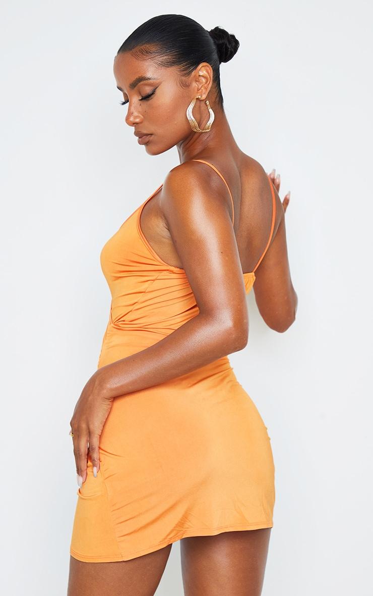 Robe moulante froncée orange slinky 2