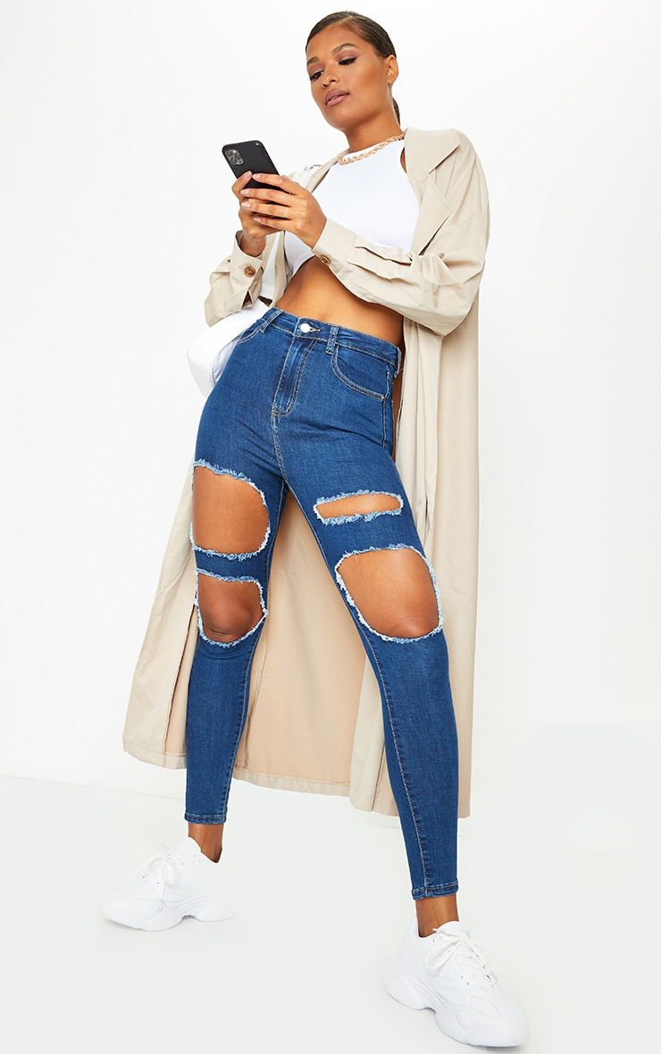 PRETTYLITTLETHING Mid Blue Wash Open Thigh Distressed 5 Pocket Skinny Jeans 1