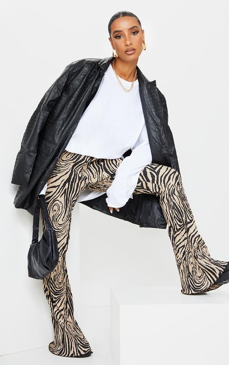 Stone Zebra Print Plisse Flared Trousers 1