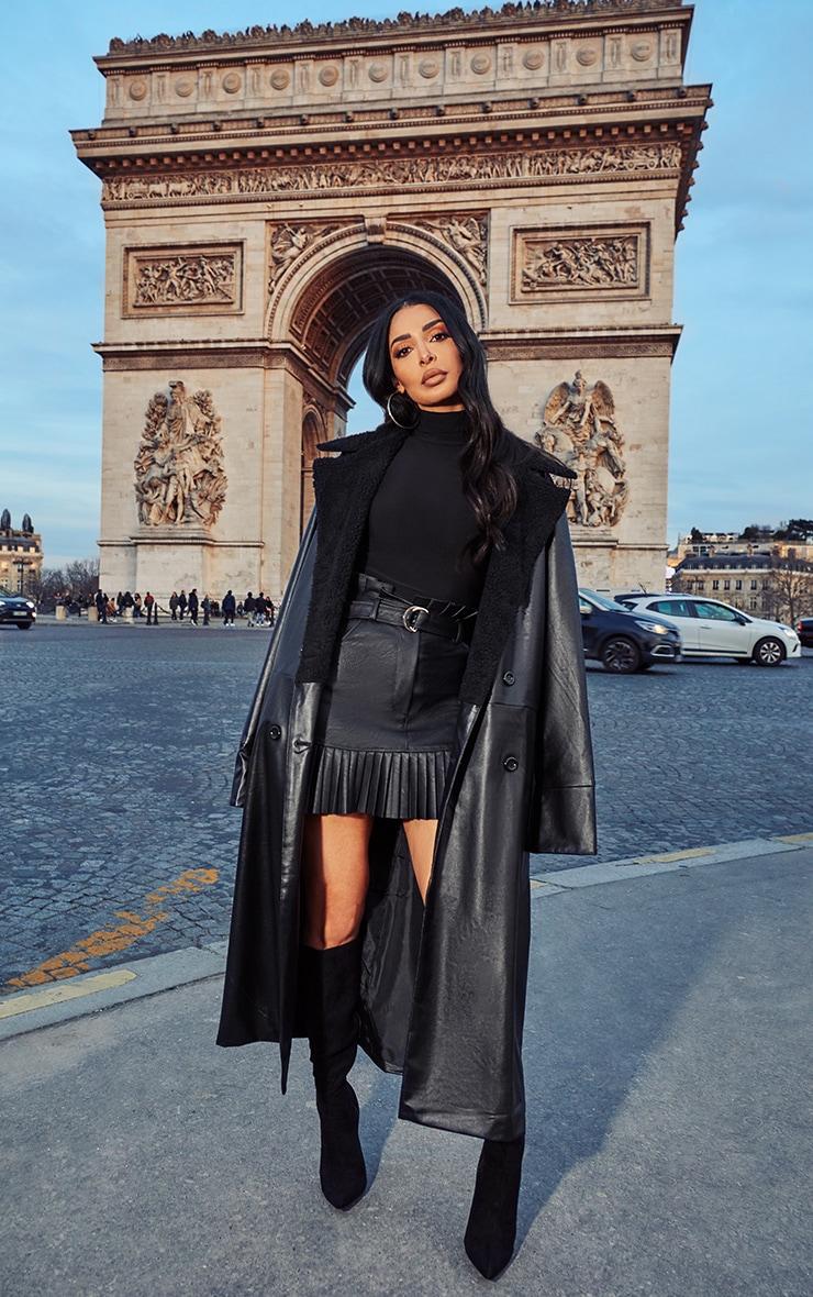 Manteau en similicuir noir à ourlet imitation mouton