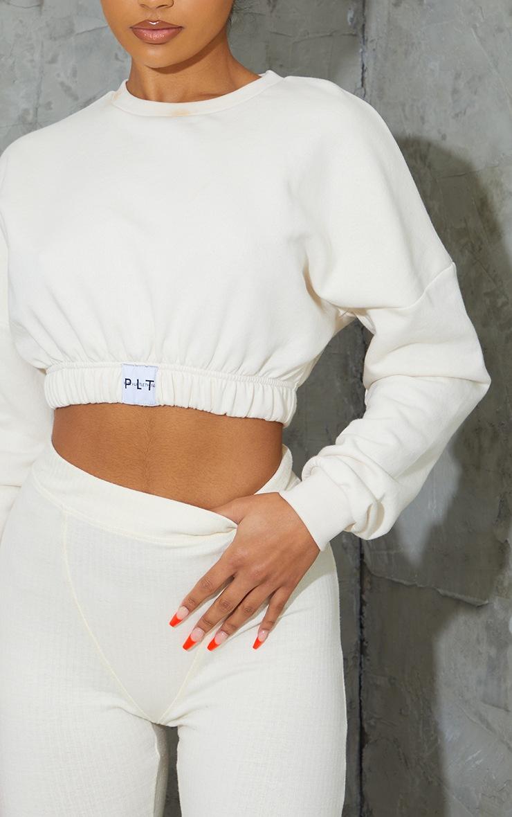 PRETTYLITTLETHING Cream Elasticated Hem Long Sleeve Crop Sweater 4